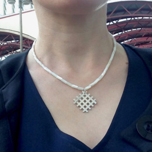 Grid Pendant Necklace - Silver and Mother Of Pearl - shown worn - handmade in sterling silver and pearlescent white mother-of-pearl semi-precious stones - with a s-hook clasp