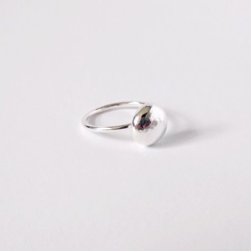 Round pebble silver ring on white background