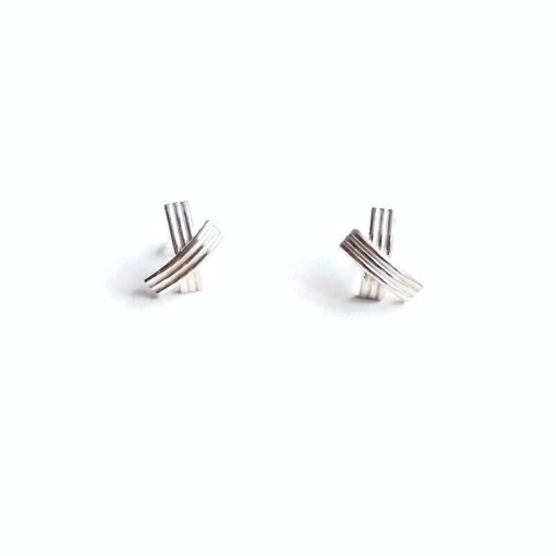XX shiny silver stud earrings - standing upright against white background