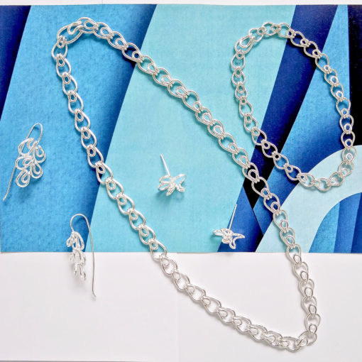 Silver Leaves Collection - silver matching set of jewellery on blue background