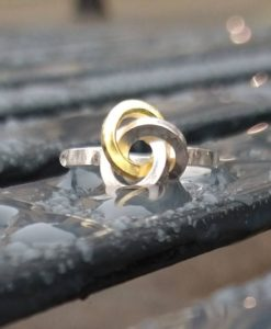 Gold & Silver Graphic Rose Ring - front view -on wet bench