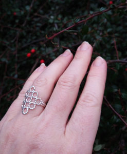 Silver Beaded Quatrefoil Ring - shown worn for scale