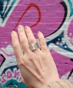 Silver Wave Ring - on model - against street art wall